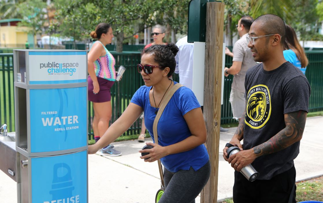 Pictured above: Miamians use a water bottle refill station, a Public Space Challenge winning project installed in 2016.