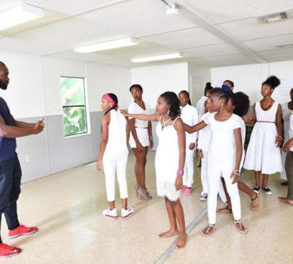 Pictured above: Tarell Alvin McCraney explains a scene in 'YALS Antigone' to the participants in his summer pilot program. Photo courtesy of The Miami Herald