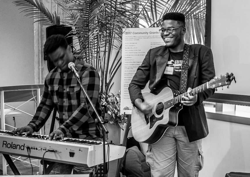 Students from 2017 Community Grants recipient Guitars Over Guns organization play at  Venture Café Miami's 50 Years of Nonprofit Innovation Thursday Takeover on June 8. Photo courtesy of L. David Stewart for Year 60 Photography.