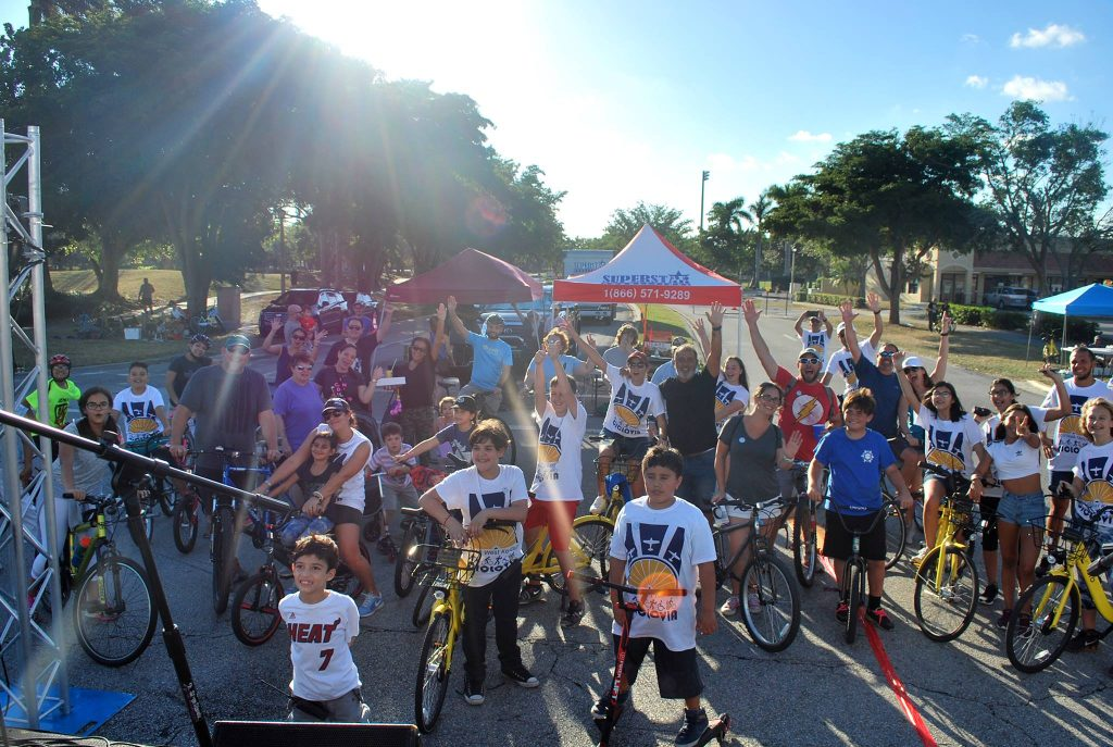 West Kendall Ciclovia participants celebrate the start of a recent event.