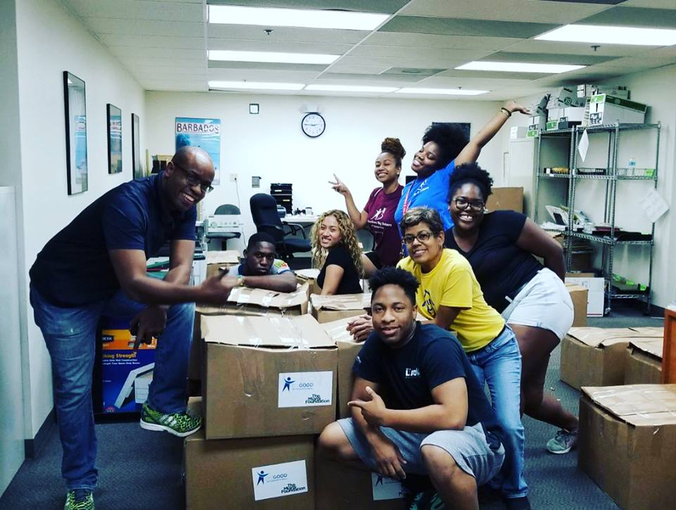 Marlon Hill and volunteers package hurricane relief supplies being shipped to Caribbean islands.