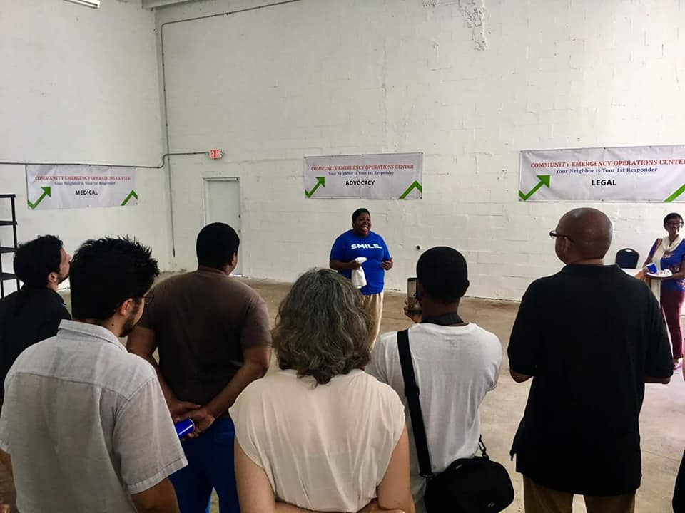 """Valencia Gunder, of nonprofit Make the Homeless Smile, gives a tour of the warehouse near Opa-Locka that will be used as a """"community emergency operations center"""" following a hurricane or other disaster."""