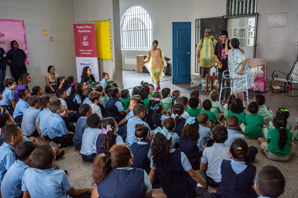 Performers put on a show for students in Puerto Rico. This show, along with numerous relief and support efforts, was funded by The Walmart Puerto Rico Relief Fund's support of Mercy Corps.