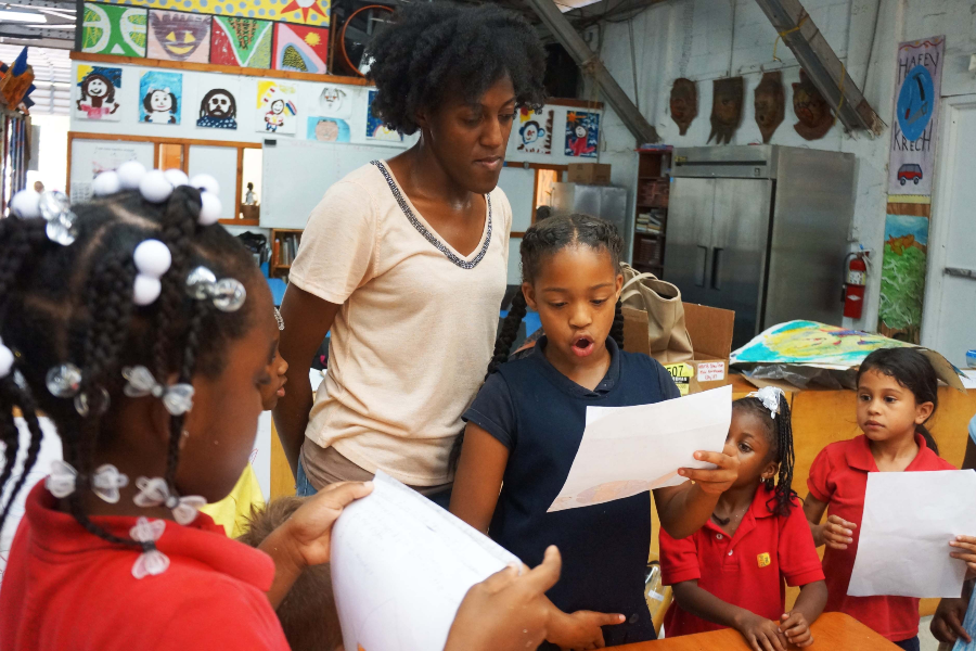 Pictured: Students reading with Arts For Learning/Miami, a Pérez CreARTE Grants Program Grantee